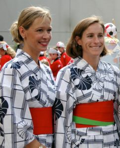 Author Kristin and friend Monique dress in traditional summer yukatas to celebrate their first Obon in Japan. (fall-2003-034)